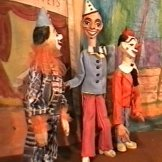 the clowns from the puppet circus